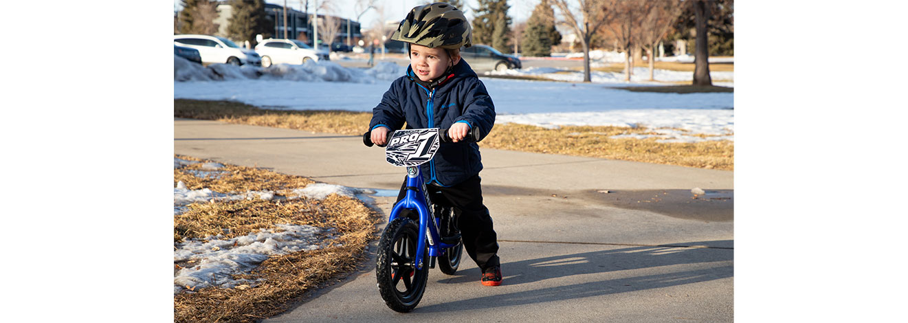 Young boy striding on Ultra Blue 12 Pro