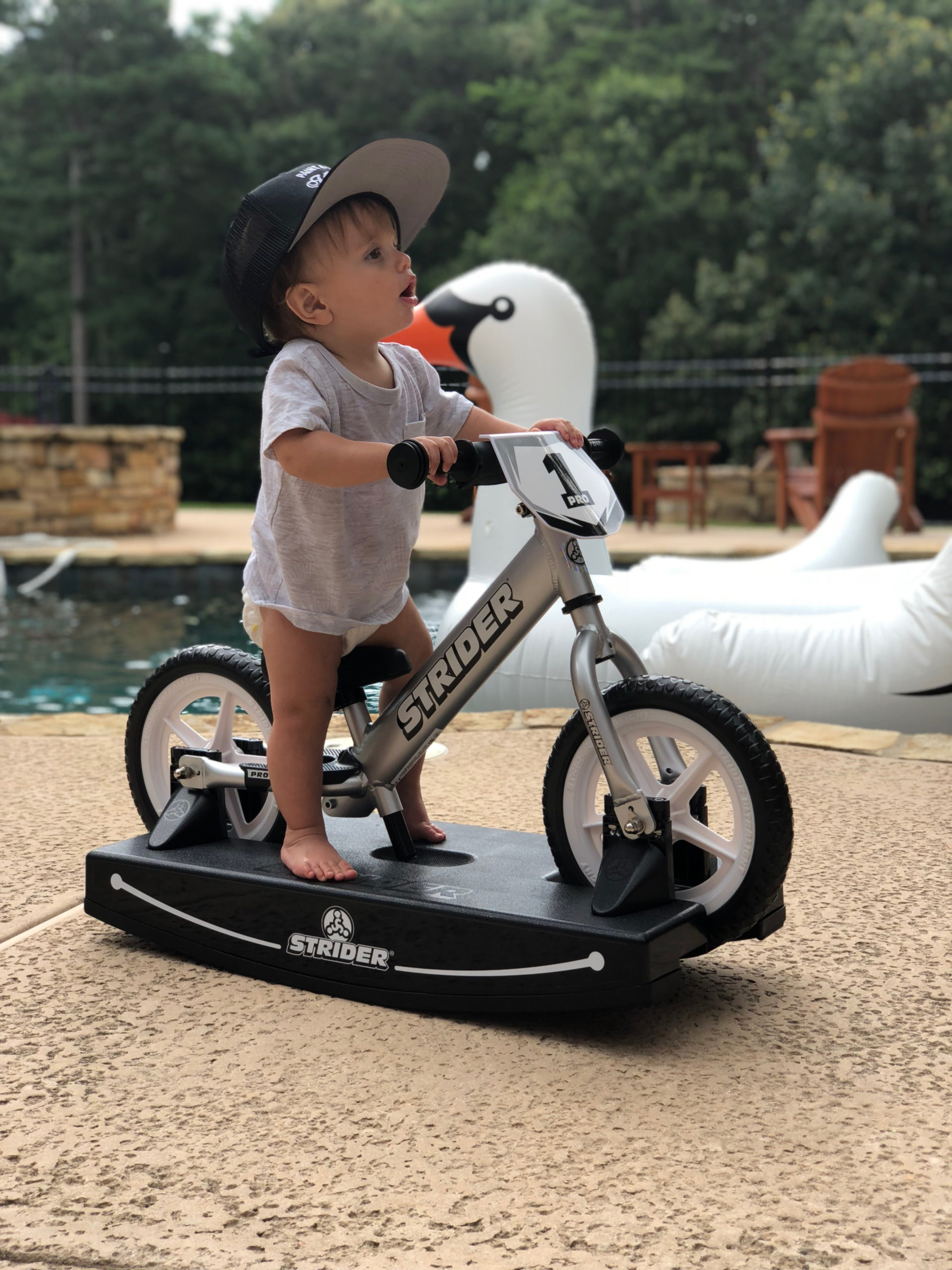 Little baby rocking on 12 Pro 2-in-1 Rocking Bike
