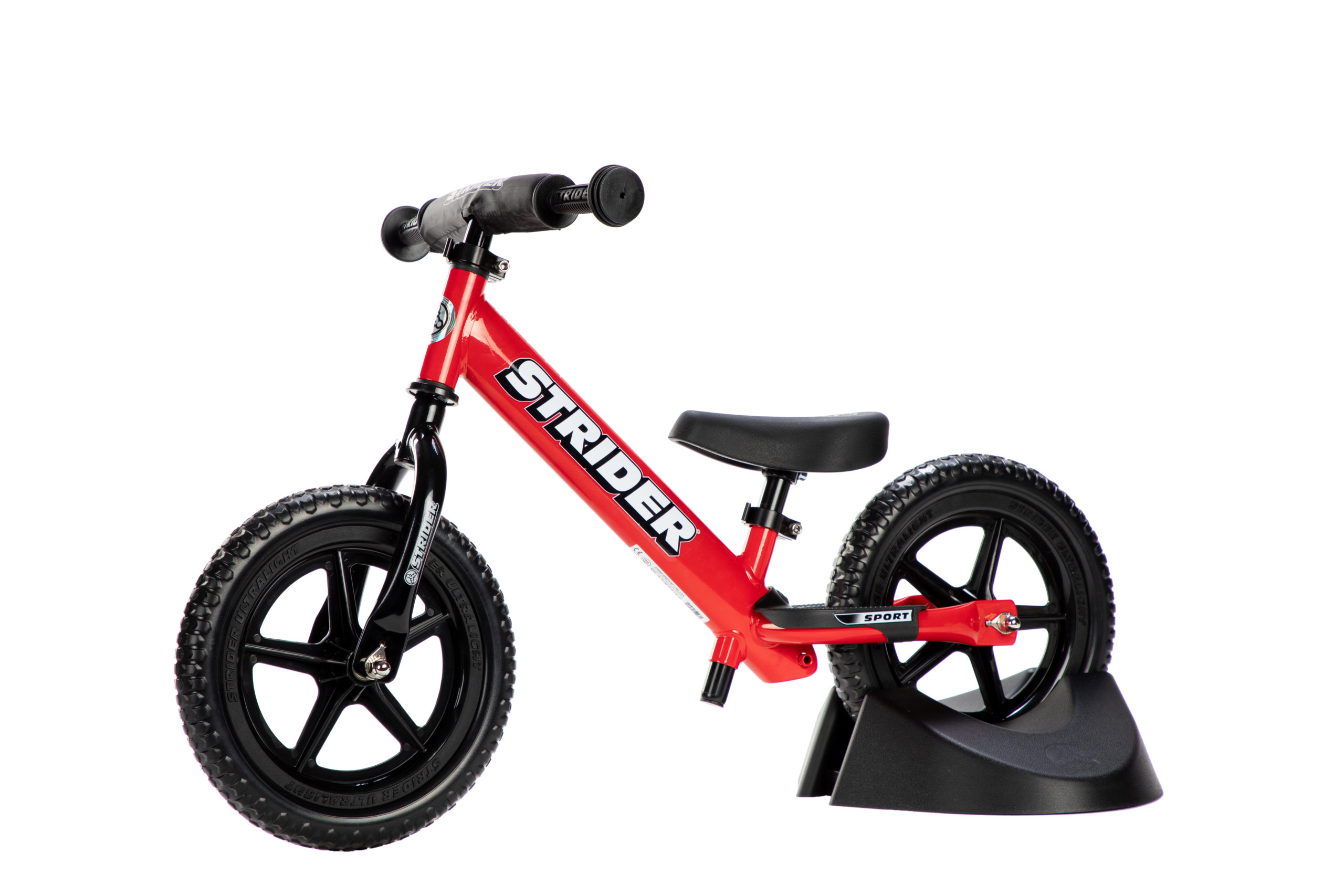 Studio image of red 12 Sport in bike stand