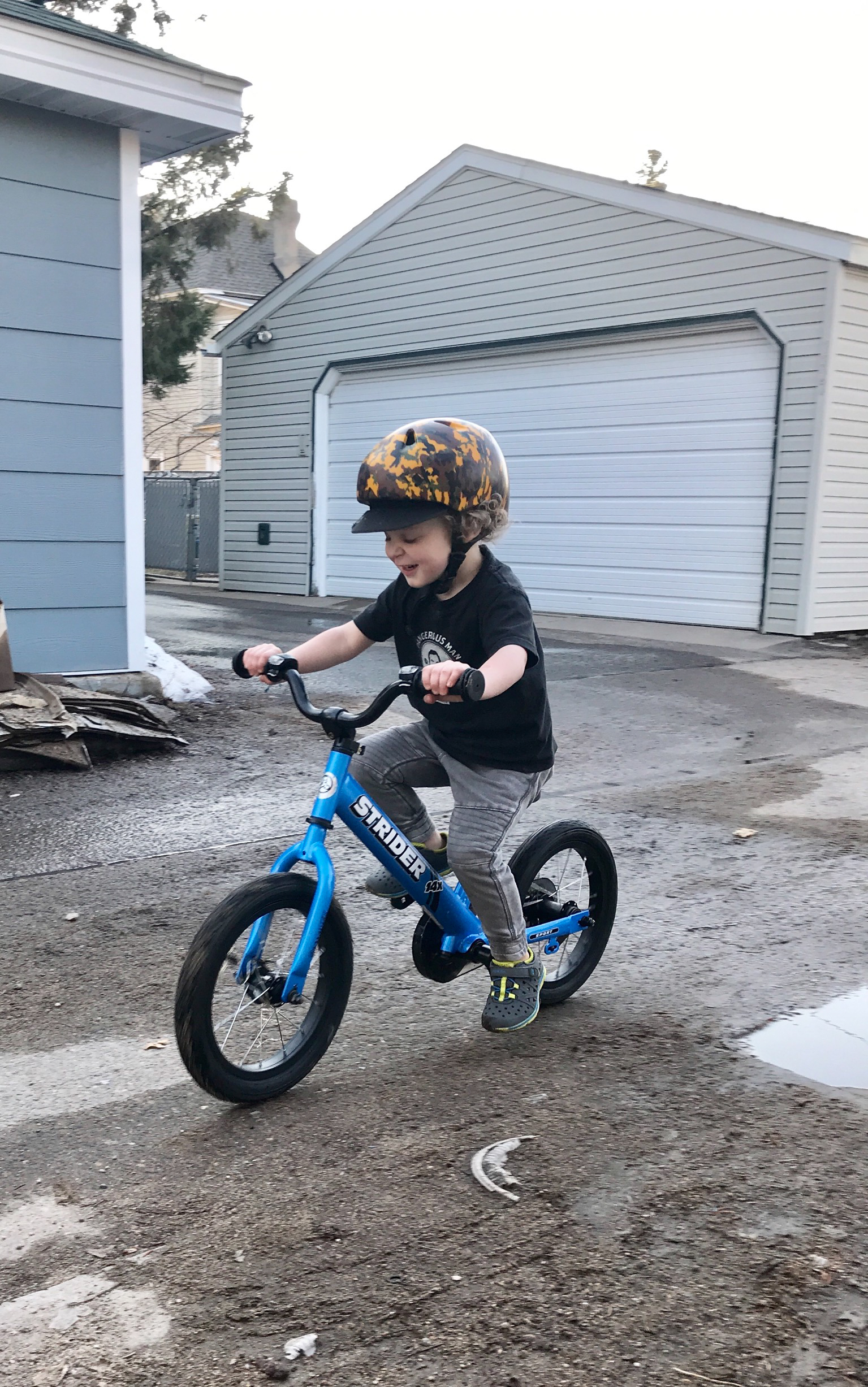 Kid pedaling blue 14x Sport with Strider headlights on handlebar