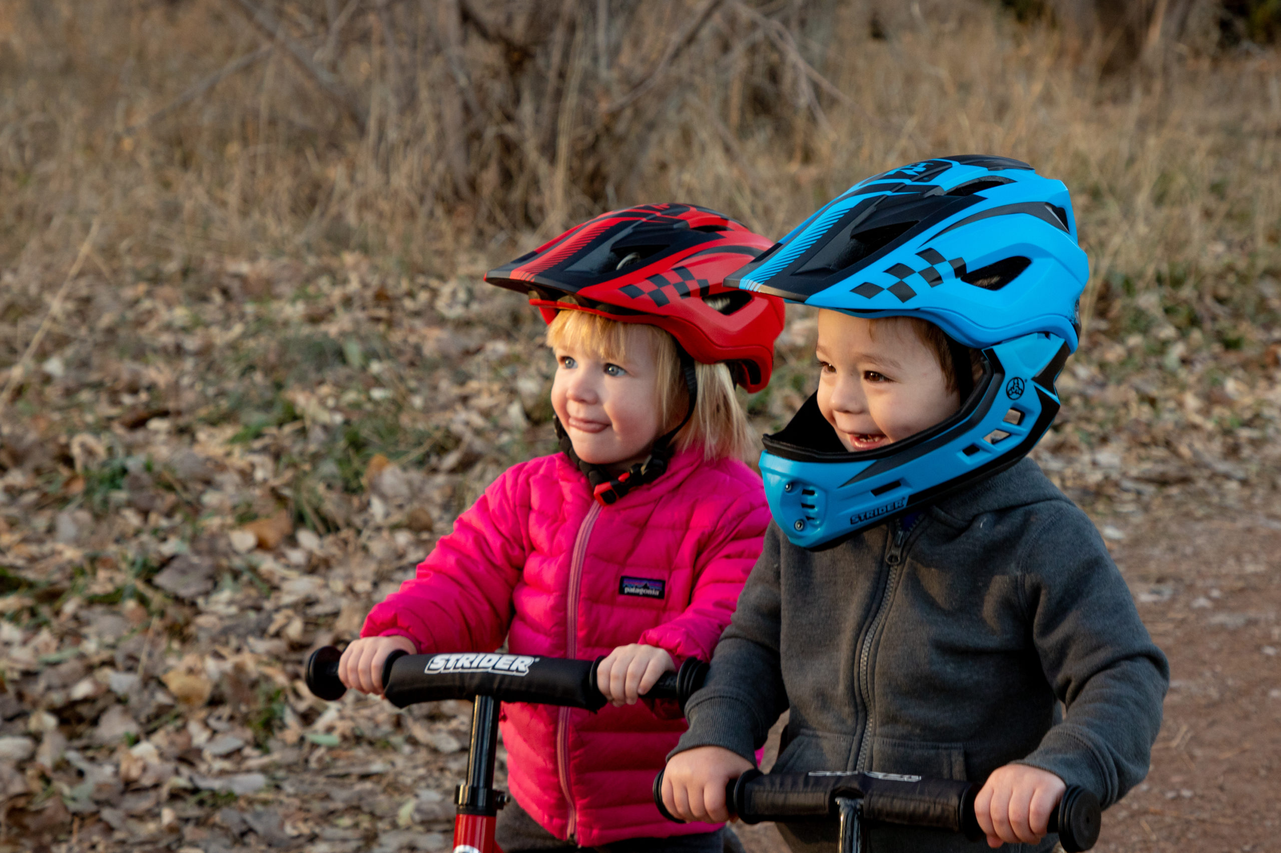 Smiling kids wearing blue ST-R Full-Faced helmet and Red ST-R Helmet without face mask