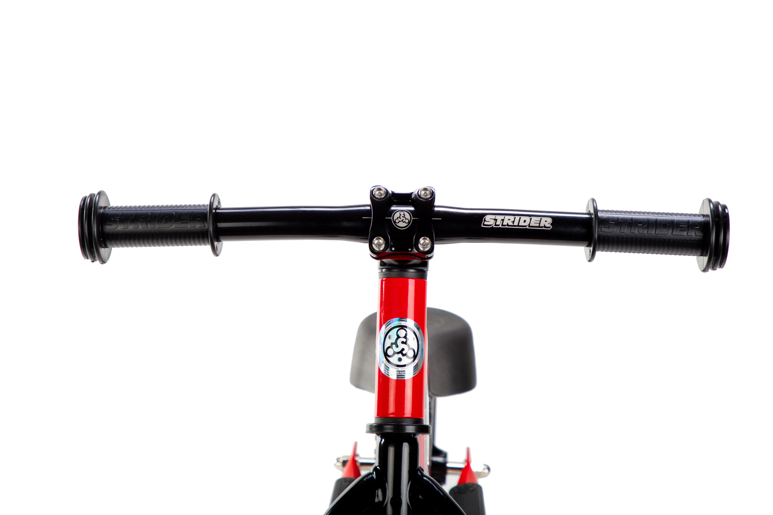 Studio image of Strider Aluminum Flat Handlebar with Grips on red 12 Sport - close-up front view