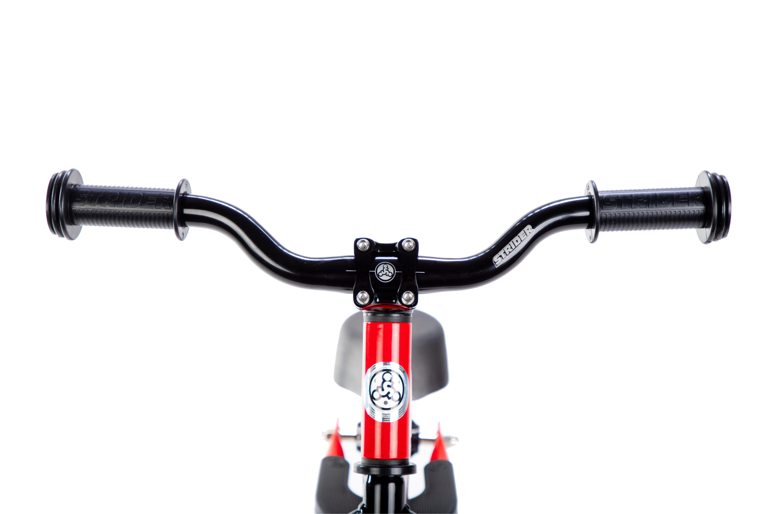 Studio image of Strider Aluminum Riser Handlebar with Grips on red 12 Sport - close-up front view