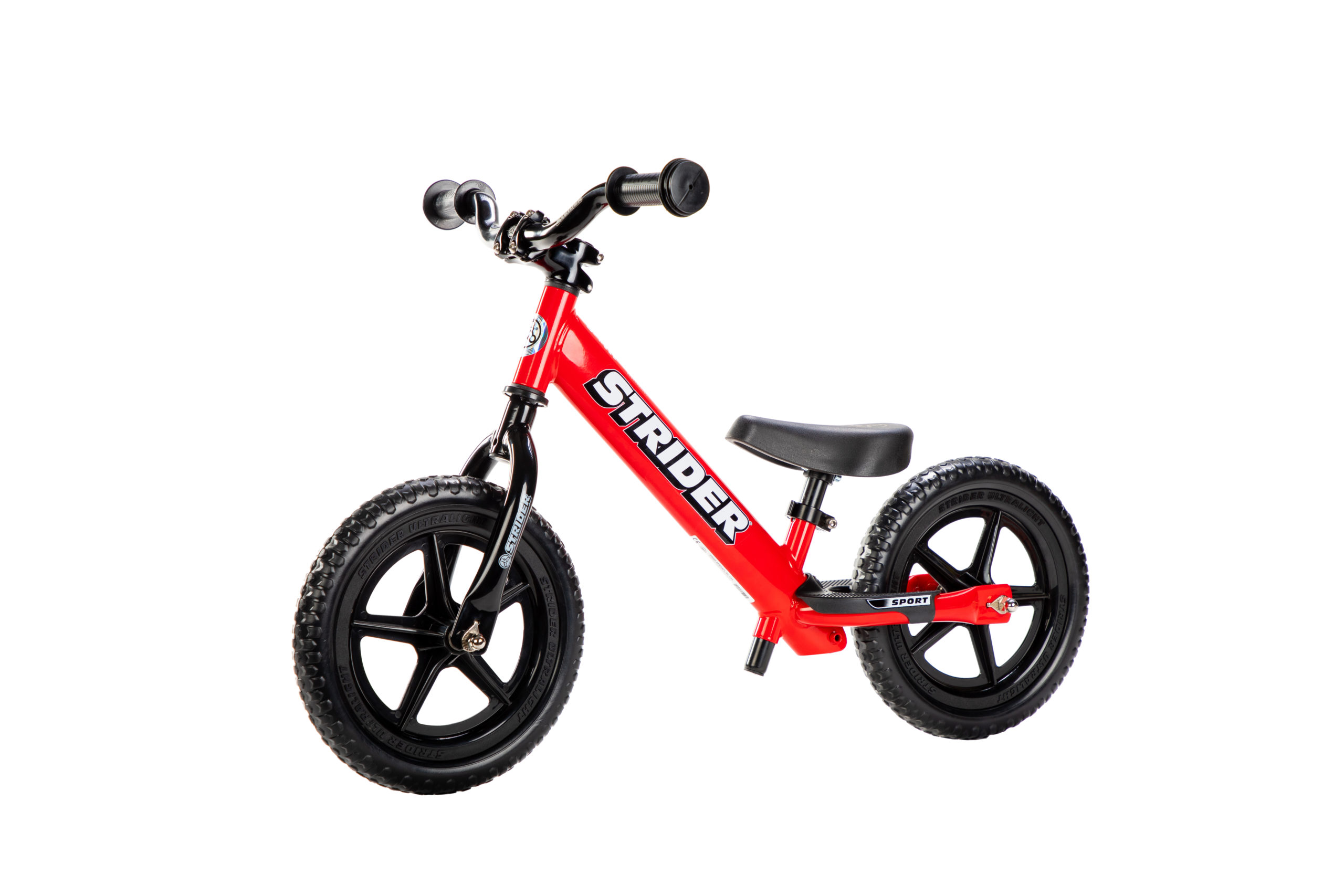 Studio image of Strider Aluminum Riser Handlebar with Grips on red 12 Sport - angle view