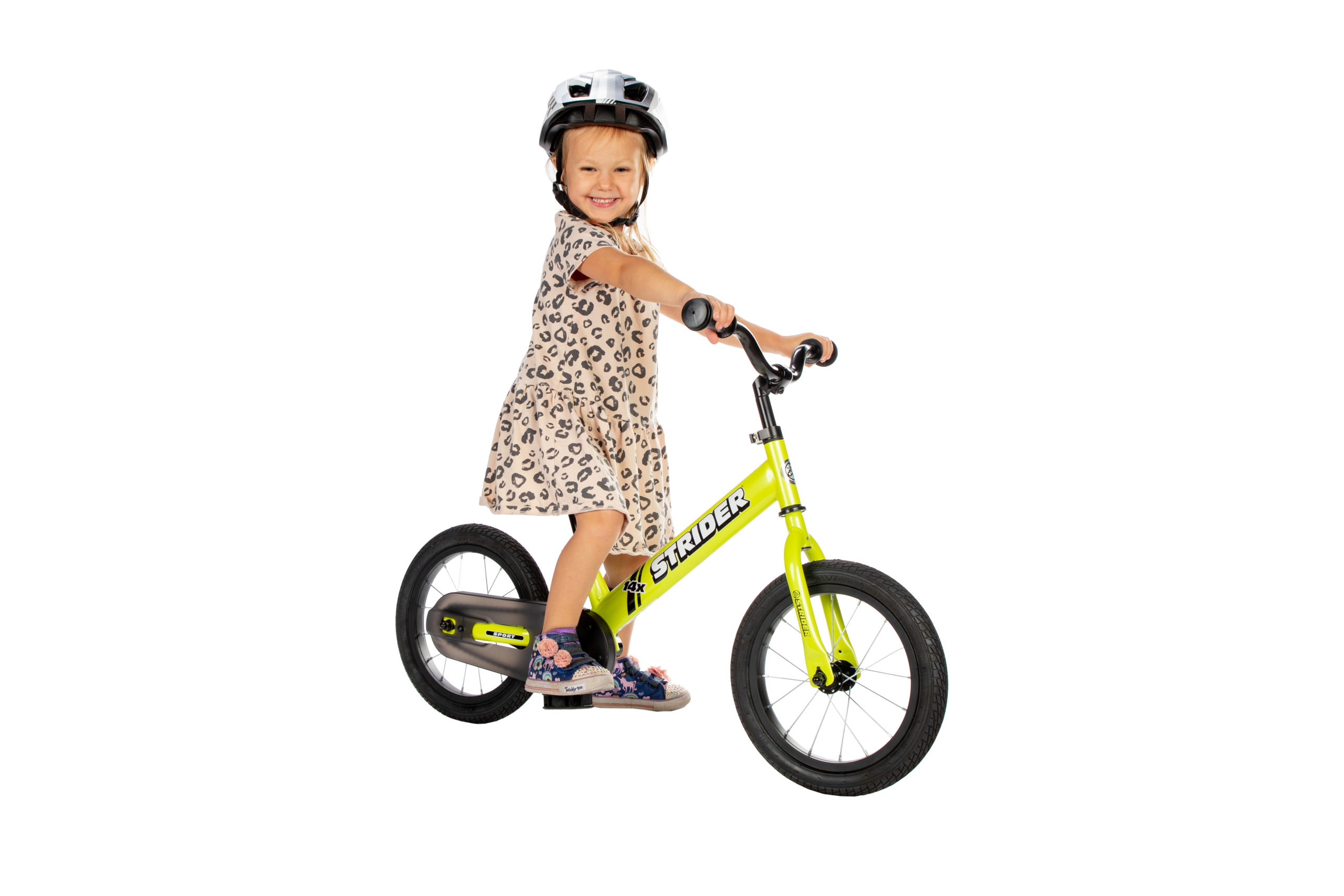 Young girl on green 14x Pedal Bike