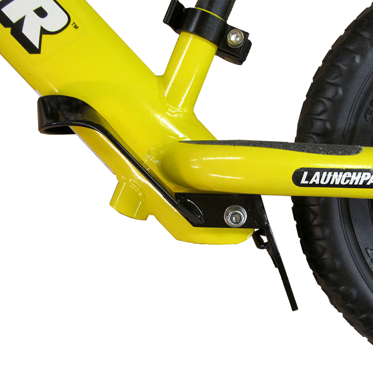 Studio image of Strider Foot Brake on yellow 12 Sport